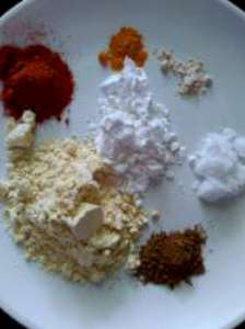 besan, rice flour, red chili powder, salt, hing, garam masala, turmeric powder